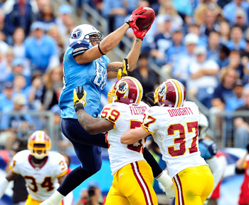 NASHVILLE, TN - NOVEMBER 21:  London Fletcher #59 and Reed Doughty #37 of the Washington Redskins force Bo Scaife #80 of the Tennessee Titans out of the end zone to prevent a touchdown at LP Field on November 21, 2010 in Nashville, Tennessee. The Redskins