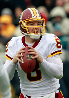 JACKSONVILLE, FL - DECEMBER 26: Quarterback Rex Grossman #8 of the Washington Redskins attempts a pass during the game against the Jacksonville Jaguars at EverBank Field on December 26, 2010 in Jacksonville, Florida.  (Photo by Sam Greenwood/Getty Images)