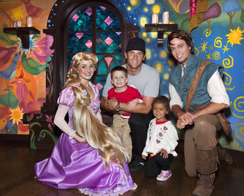 ANAHEIM, CA - APRIL 21:  In this handout photo provided by Disney Parks, New England Patriots Quarterback Tom Brady, his son Jack (4) and niece Jordan (5), meet Rapunzel and Flynn Rider of Disney's animated film, 'Tangled,' while celebrating Jordan's fift