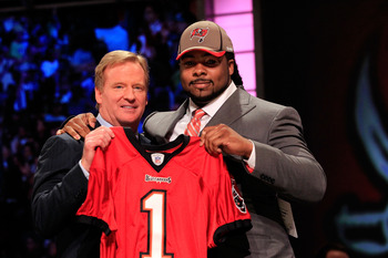 NEW YORK, NY - APRIL 28:  NFL Commissioner Roger Goodell poses for a phot with Adrian Clayborn, #20 overall pick by the Tampa Bay Buccaneers, on stage during the 2011 NFL Draft at Radio City Music Hall on April 28, 2011 in New York City.  (Photo by Chris