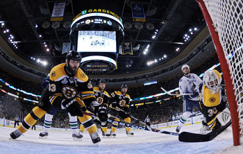 BOSTON, MA - JUNE 13:  Zdeno Chara #33 and Tim Thomas #30 of the Boston Bruins defends the net against the Vancouver Canucks during Game Six of the 2011 NHL Stanley Cup Final at TD Garden on June 13, 2011 in Boston, Massachusetts.  (Photo by Elsa/Getty Im