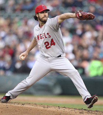 SEATTLE - JUNE 13:  Starting pitcher Dan Haren #24 of the Los Angeles Angels of Anaheim pitches against the Seattle Mariners at Safeco Field on June 13, 2011 in Seattle, Washington. (Photo by Otto Greule Jr/Getty Images)