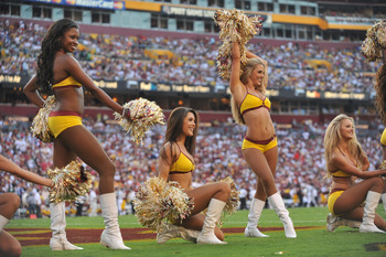 LANDOVER - SEPTEMBER 19:  Cheerleaders for the Washington Redskins cheer during the game against the Houston Texans at FedExField on September 19, 2010 in Landover, Maryland. The Texans defeated the Redskins in overtime 30-27. (Photo by Larry French/Getty