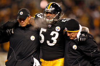 PITTSBURGH, PA - JANUARY 23:  Maurkice Pouncey #53 of the Pittsburgh Steelers is helped off of the field after being injured in the first quarter against the New York Jets during the 2011 AFC Championship game at Heinz Field on January 23, 2011 in Pittsbu