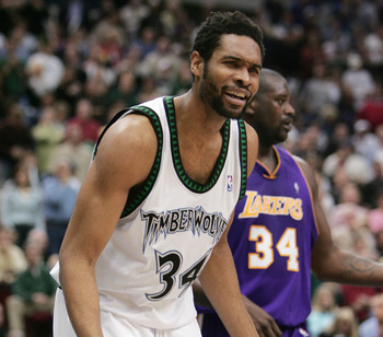 MINNEAPOLIS - MAY 23:  Michael Olowokandi #34 of the Minnesota Timberwolves reacts after the play against the Los Angeles Lakers in Game two of the Western Conference Finals during the 2004 NBA Playoffs at Target Center on May 23, 2004 in Minneapolis, Min