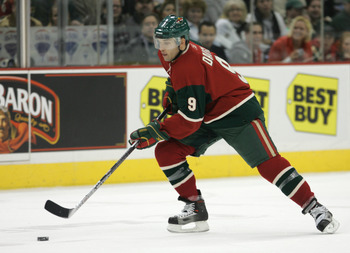 SAINT PAUL - JANUARY 9: Alexandre Daigle #9 of the Minnesota Wild skates with the puck during the game against the Dallas Stars at the Xcel Energy Center on January 9, 2006 in Saint Paul, Minnesota. The Stars won 2-1. (Photo by Bruce Bennett/Getty Images)