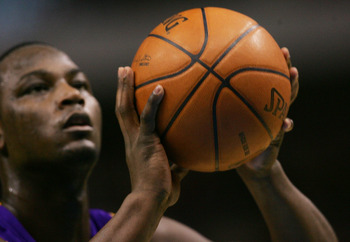DALLAS - JANUARY 25:  Center Kwame Brown #54 of the Los Angeles Lakers grips the ball as he takes a free throw against the Dallas Mavericks on January 25, 2008 at American Airlines Center in Dallas, Texas.  NOTE TO USER: User expressly acknowledges and ag