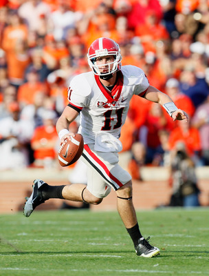 AUBURN, AL - NOVEMBER 13:  Quarterback Aaron Murray #11 of the Georgia Bulldogs rushes out of the pocket against the Auburn Tigers at Jordan-Hare Stadium on November 13, 2010 in Auburn, Alabama.  (Photo by Kevin C. Cox/Getty Images)