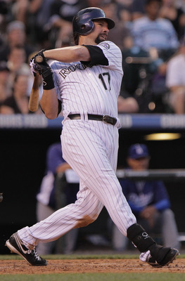 DENVER, CO - JUNE 10:  Todd Helton #17 of the Colorado Rockies hits a two RBI single off of starting pitcher Chad Billingsley of the Los Angeles Dodgers to give the Rockies a 3-0 lead in the fifth inning at Coors Field on June 10, 2011 in Denver, Colorado