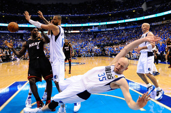 DALLAS, TX - JUNE 09: Brian Cardinal #35 of the Dallas Mavericks falls to the court while defending against LeBron James #6 of the Miami Heat  in Game Five of the 2011 NBA Finals at American Airlines Center on June 9, 2011 in Dallas, Texas.  NOTE TO USER: