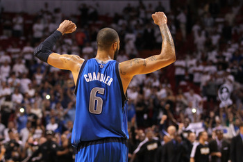 MIAMI, FL - JUNE 12:  Tyson Chandler #6 of the Dallas Mavericks celebrates after the Mavricks won 105-95 against the Miami Heat in Game Six of the 2011 NBA Finals at American Airlines Arena on June 12, 2011 in Miami, Florida. NOTE TO USER: User expressly
