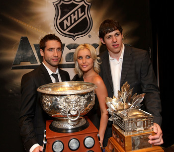 LAS VEGAS - JUNE 18:  (L-R) Max Talbot, Oxsana Kondakov and Evgeni Malkin pose with the Art Ross Trophy and the Conn Smythe Trophy following the 2009 NHL Awards at the Palms Casino Resort on June 18, 2009 in Las Vegas, Nevada.  (Photo by Bruce Bennett/Get
