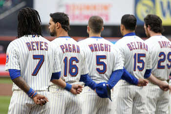 NEW YORK, NY - APRIL 08:  (L-R) Jose Reyes #7, Angel Pagan #16, David Wright #5, Carlos Beltran #15 and Ike Davis #29 of the New York Mets line up during pregame festivities against the Washington Nationals during the Mets' Home Opener at Citi Field on Ap