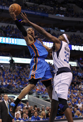 DALLAS, TX - MAY 25:  Russell Westbrook #0 of the Oklahoma City Thunder goes up for a shot against Brendan Haywood #33 of the Dallas Mavericks in the second half in Game Five of the Western Conference Finals during the 2011 NBA Playoffs at American Airlin