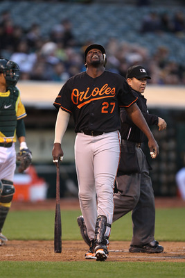 OAKLAND, CA - MAY 27:  Vladimir Guerrero #27 of the Baltimore Orioles reacts after being hit by a pitch against the Oakland Athletics during a Major League Baseball game at the Oakland-Alameda County Coliseum on May 27, 2011 in Oakland, California.  (Phot