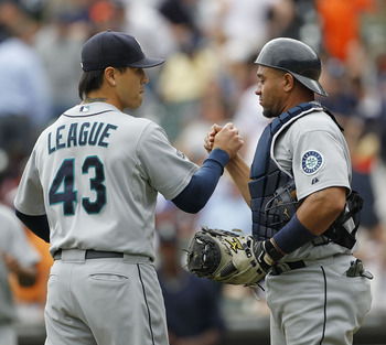 DETROIT - JUNE 12: Brandon League #43 and Miguel Olivo #30 of the Seattle Mariners celebrate a 7-3 win over the Detroit Tigers at Comerica Park on June 12, 2011 in Detroit, Michigan.  (Photo by Leon Halip/Getty Images)