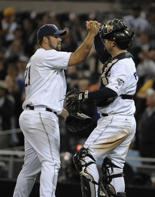 SAN DIEGO, CA - JUNE 7: (L-R) Heath Bell #21 of the San Diego Padres, is congratulated by catcher Kyle Phillips after getting the final out in the ninth inning of a baseball game against the Colorado Rockies at Petco Park on June 7, 2011 in San Diego, Cal