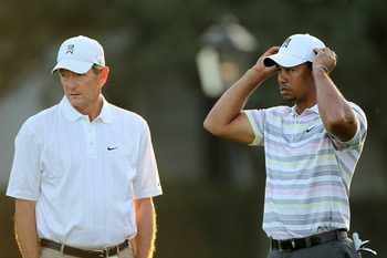AUGUSTA, GA - APRIL 05:  Tiger Woods waits with swing coach Hank Haney on the practice range during a practice round prior to the 2010 Masters Tournament at Augusta National Golf Club on April 5, 2010 in Augusta, Georgia.  (Photo by Jamie Squire/Getty Ima