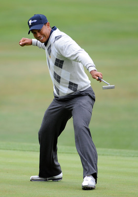 SAN FRANCISCO - OCTOBER 10:  Tiger Woods of the USA Team celebrates his putt for a birdie to win the 17th hole during the Day Three Morning Foursome Matches of The Presidents Cup at Harding Park Golf Course on October 10, 2009 in San Francisco, California