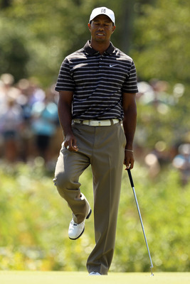 NORTON, MA - SEPTEMBER 05:  Tiger Woods reacts on the eighth green during the third round of the Deutsche Bank Championship at TPC Boston on September 5, 2010 in Norton, Massachusetts.  (Photo by Mike Ehrmann/Getty Images)