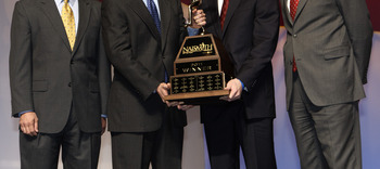 HOUSTON - APRIL 03:  Jimmer Fredette of BYU receives the 2011 Naismith Trophy Presented by AT&T from David Christopher of AT&T during the NABC Guardians of the Game Awards Program on April 3, 2011 in Houston, Texas.  Joining them on stage are Eric Oberman