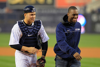 NEW YORK, NY - APRIL 13: Kemba Walker (R), guard for the Connecticut Huskies walks with Russell Martin #55 of the New York Yankees after he throws out the first pitch before the game between the New York Yankees and the Baltimore Orioles at Yankee Stadium