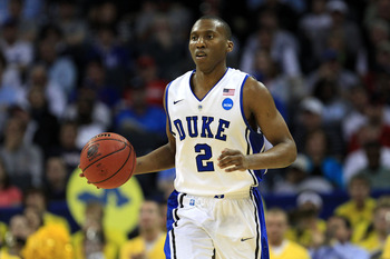 CHARLOTTE, NC - MARCH 20:  Nolan Smith #2 of the Duke Blue Devils moves the ball upcourt while taking on the Michigan Wolverines during the third round of the 2011 NCAA men's basketball tournament at Time Warner Cable Arena on March 20, 2011 in Charlotte,