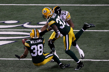 ARLINGTON, TX - FEBRUARY 06:  Tramon Williams #38 of the Green Bay Packers muffs a punt as Sam Shields #37 and Keenan Lewis #23 of the Pittsburgh Steelers attempt to recover during Super Bowl XLV at Cowboys Stadium on February 6, 2011 in Arlington, Texas.