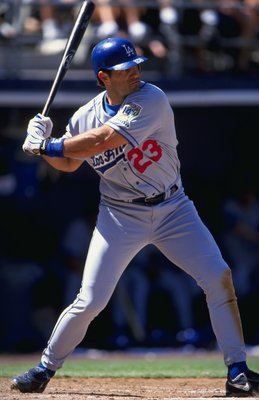 18 Apr 1999:  Eric Karros #23 of the Los Angeles Dodgers swings at the ball during the game against the San Diego Padres at the Qualcomm Stadium in San Diego, California. The Padres defeated the Dodgers 4-3. Mandatory Credit: Todd Warshaw  /Allsport