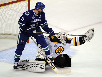 VANCOUVER, BC - JUNE 10:  Tim Thomas #30 of the Boston Bruins makes a glove save against Manny Malhotra #27 of the Vancouver Canucks during Game Five of the 2011 NHL Stanley Cup Final at Rogers Arena on June 10, 2011 in Vancouver, British Columbia, Canada