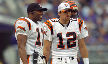 BALTIMORE - NOVEMBER 10:  Quarterback's Gus Frerotte #12 and Akili Smith #11 of the Cincinnati Bengals stand on the field during the NFL game against the Baltimore Ravens at the Ravens Stadium on November 10, 2002 in Baltimore, Maryland.  The Ravens defea