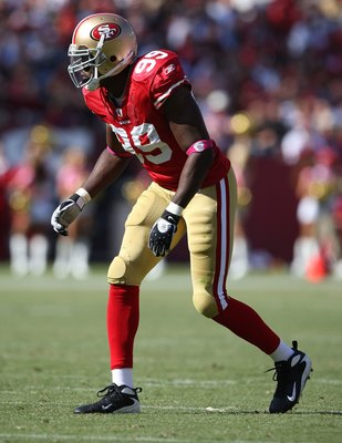 SAN FRANCISCO - OCTOBER 04:  Manny Lawson #99 of the San Francisco 49ers in action against the St. Louis Rams during an NFL game on October 4, 2009 at Candlestick Park in San Francisco, California.  (Photo by Jed Jacobsohn/Getty Images)