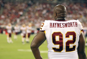 GLENDALE, AZ - SEPTEMBER 02:  Defensive tackle Albert Haynesworth #92 of the Washington Redskins stands on the sidelines during preseason NFL game against the Arizona Cardinals at the University of Phoenix Stadium on September 2, 2010 in Glendale, Arizona