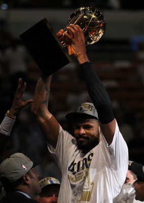 MIAMI, FL - JUNE 12:  Tyson Chandler #6 of the Dallas Mavericks celebrates with the Larry O'Brien trophy after the Mavericks won 105-95 against the Miami Heat in Game Six of the 2011 NBA Finals at American Airlines Arena on June 12, 2011 in Miami, Florida
