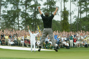 AUGUSTA, GA - APRIL 11:  Phil Mickelson  jumps in the air after sinking his birdie putt to win the Masters by one shot on the 18th green during the final round of the Masters at the Augusta National Golf Club on April 11, 2004 in Augusta, Georgia.  (Photo