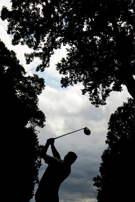 BETHESDA, MD - JUNE 14:  Graeme McDowell of Northern Ireland hits a shot during a practice round prior to the start of the 111th U.S. Open at Congressional Country Club on June 14, 2011 in Bethesda, Maryland.  (Photo by Ross Kinnaird/Getty Images)