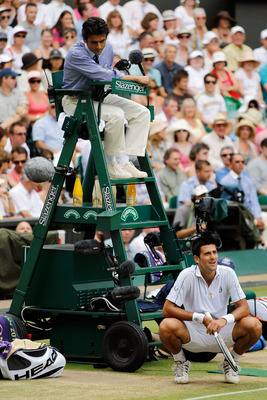 LONDON, ENGLAND - JULY 02:  Novak Djokovic of Serbia reacts as he speaks to the Chair Umpire after a line call during the Men�s Semi Final match against Tomas Berdych of Czech Republic on Day Eleven of the Wimbledon Lawn Tennis Championships at the All En