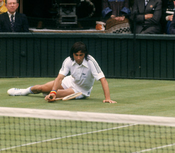 Romanian tennis player Ilie Nastase during a match against Tom Okker at Wimbledon, 1977. (Photo by Tony Duffy/Getty Images)