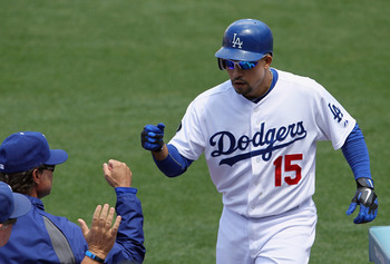 LOS ANGELES, CA - MAY 29:  Rafael Furcal #15 of the Los Angeles Dodgers receives high fives from the dougout after hitting a two-run home run against the Florida Marlins in the third inning at Dodger Stadium on May 29, 2011 in Los Angeles, California. The