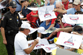 BETHESDA, MD - JUNE 14:  Phil Mickelson signs autographs for fans during a practice round prior to the start of the 111th U.S. Open at Congressional Country Club on June 14, 2011 in Bethesda, Maryland.  (Photo by Ross Kinnaird/Getty Images)