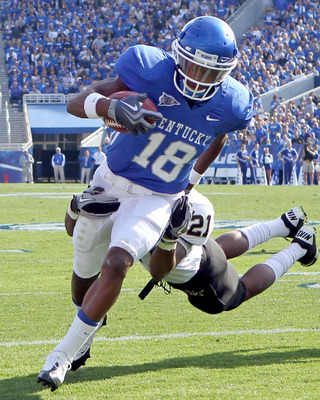 LEXINGTON, KY - NOVEMBER 13:  Randall Cobb #18 of the Kentucky Wildcats runs with the ball while defended by Sean Richardson #21 of the Vanderbilt Commodores during the game at Commonwealth Stadium on November 13, 2010 in Lexington, Kentucky. Kentucky won