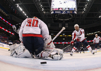 TAMPA, FL - MAY 03: A shot by Sean Bergenheim #10 of the Tampa Bay Lightning eludes Michal Neuvirth #30 of the Washington Capitals in Game Three of the Eastern Conference Semifinals during the 2011 NHL Stanley Cup Playoffs at St Pete Times Forum on May 3,