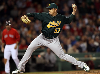 BOSTON, MA - JUNE 03:  Brian Fuentes #57 of the Oakland Athletics delivers a pitch to Carl Crawford of the Boston Red Sox in the seventh inning on June 3, 2011 at Fenway Park in Boston, Massachusetts.  (Photo by Elsa/Getty Images)