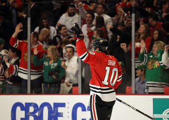 CHICAGO, IL - MARCH 14: Patrick Sharp #10 of the Chicago Blackhawks celebrates a goal scored against the San Jose Sharks at the United Center on March 14, 2011 in Chicago, Illinois. The Blackhawks defeated the Sharks 6-3. (Photo by Jonathan Daniel/Getty I