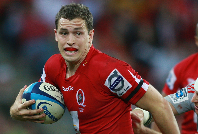 BRISBANE, AUSTRALIA - MAY 29: Luke Morahan of the Reds runs with the ball during the round 15 Super Rugby match between the Reds and the Crusaders at Suncorp Stadium on May 29, 2011 in Brisbane, Australia.  (Photo by Jonathan Wood/Getty Images)