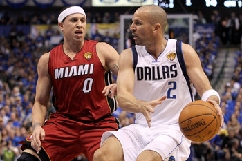 DALLAS, TX - JUNE 05:  Jason Kidd #2 of the Dallas Mavericks drives on Mike Bibby #0 of the Miami Heat in the first quarter in Game Three of the 2011 NBA Finals at American Airlines Center on June 5, 2011 in Dallas, Texas.  NOTE TO USER: User expressly ac