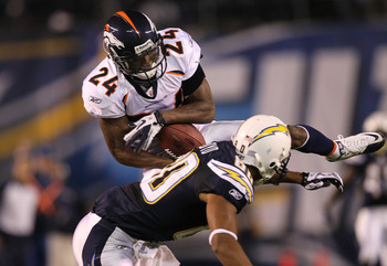 SAN DIEGO - NOVEMBER 22:  Cornerback Champ Bailey #24 of the Denver Broncos intercepts a pass over wide receiver Malcom Floyd #80 of the San Diego Chargers at Qualcomm Stadium on November 22, 2010 in San Diego, California.  (Photo by Stephen Dunn/Getty Im
