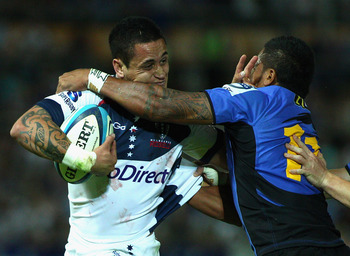 PERTH, AUSTRALIA - APRIL 02:   Richard Kingi of the Rebels fends off an opponent during the round seven Super Rugby match between the Western Force and the Melbourne Rebels at nib Stadium on April 2, 2011 in Perth, Australia.  (Photo by Mark Dadswell/Gett
