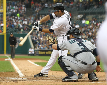 DETROIT, MI - JUNE 10:  Catcher Alex Avila #13 of the Detroit Tigers makes contact on a pitch during a MLB game against the Seattle Mariners at Comerica Park on June 10, 2011 in Detroit, Michigan.  Seattle defeated Detroit 3-2.  (Photo by Dave Reginek/Get