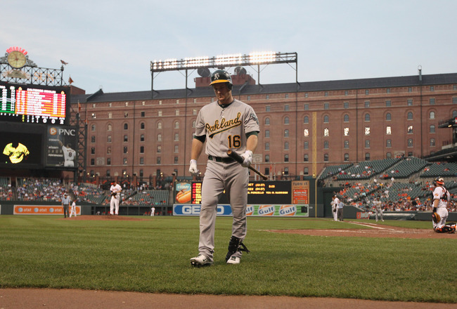 BALTIMORE, MD - JUNE 07: Josh Willingham #16 of the Oakland Athletics walks back to the dugout after striking out against the Baltimore Orioles during the fourth inning at Oriole Park at Camden Yards on June 7, 2011 in Baltimore, Maryland.  (Photo by Rob